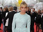 Leading the glamour: Sienna Miller shows off her style as she jets into London to see if she is a winner at the 2013 TV BAFTAs, wearing a cute powder blue frock for the occasion