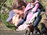 Zara Phillips gives a friend a piggyback through a 'water feature'