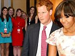 Michelle Obama has beaten hundreds of adoring women to get closest to Prince Harry after Britain's most eligible bachelor joined her at the White House at the start of his week-long U.S. tour.