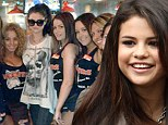 'Love my Hooters girls!' Selena Gomez covers up as she grabs a quick meal with friends at the stripped-down eatery after radio interview