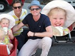 Hold on to your hat! Neil Patrick Harris and David Burtka take their fraternal twins for a spin at the Farmer's Market