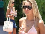 That will make them drool! Model Petra Benova struts her tanned and toned body in pastel bikini top and tiny denim skirt