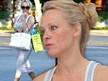 Striped beauty: Pamela Anderson wore a grey and white striped sundress on Saturday while out in Malibu