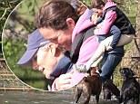 Zara Phillips gives a friend a piggyback through a 'water feature'