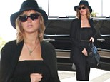 No time for risky fashion! Jennifer Lawrence sticks to head-to-toe black as she hurries through LAX to catch a flight