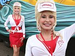 Ageless beauty: Dolly Parton, 67, revealed her stunning figure in a form-fitting red dress for Homecoming Weekend at Dollywood, in Tennessee, on Friday