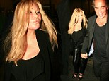 Getting her Catwoman on! Jocelyn Wildenstein goes clubbing with designer beau Lloyd Klein in tight leather pants