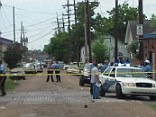 At least 12 people including a 10-year-old girl have been shot at a Mother's Day Parade in New Orleans. No suspects are in custody. Police are looking for three people in connection with the attack.