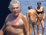 He's feeling wild! Roberto Cavalli wears tiny leopard print trunks as he enjoys a day with a female friend on his yacht in Monaco