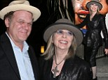 Hatagirl! Diane Keaton wears matching fedora as she hams it up with John C Reilly at art event