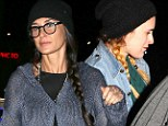 Beanies and braids! Demi Moore and daughter Rumer Willis coordinate their outfits for music concert