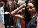 Which way? Zoe Saldana gets going in the right direction with a little help from her friends at a Los Angeles mall