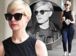 In search of an edge? Anne Hathaway continues her Warhol-inspired arty reinvention in classic black shades