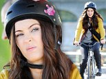 Megan Fox puts on a pouty face as wears a boxy helmet while riding through the streets of New York on the set of Teenage Mutant Ninja Turtles