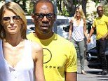 They can't get enough of each other! Eddie Murphy and his model girlfriend Paige Butcher clutch hands on daily coffee run