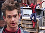 Back in action! Andrew Garfield struts around in Spidey outfit while confronting a new villain in The Amazing Spider-Man 2