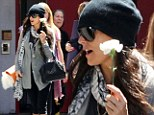 Flower power! Demi Moore's mission of relaxation is accomplished as she leaves yoga class bearing a single white rose