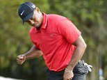 Celebrate: Tiger Woods sinks a birdie on the sixth hole on the way to claiming the Players Championship