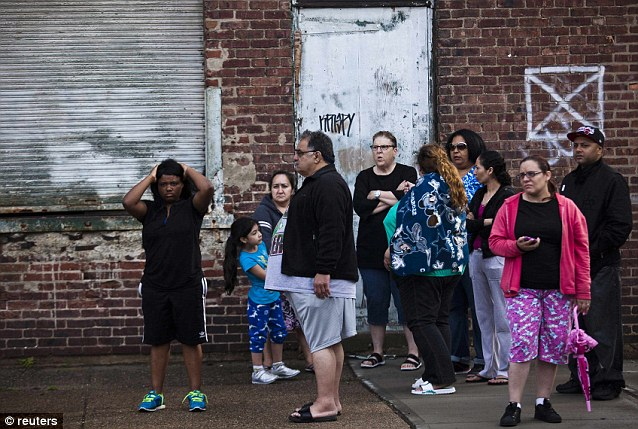 Pushed out: Residents from Grand Street in South Trenton were evacuated and waited in fear for the standoff's ultimate conclusion