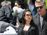 Putting on their Sunday best: Alec Baldwin leaves hot temper behind him and showers pregnant wife Hilaria with affectionate picnic