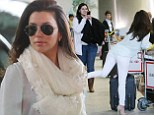 Bottoms up! Eva Longoria shows off her pert derriere as she poses with her luggage at the airport in Paris