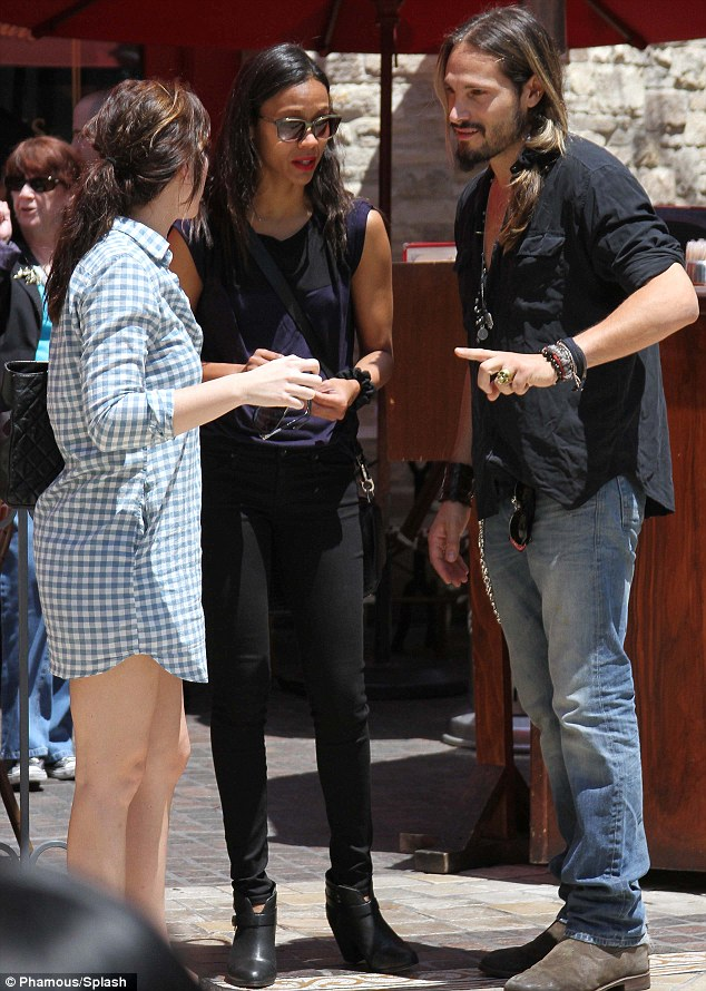 Pointed conversation: Zoe Saldana met up with friends on Friday at The Grove and appeared to ask them for directions