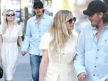 Can't hide their love! Kirsten Dunst and Garrett Hedlund get cosy en route to a romantic date night