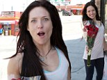 Are those for a special someone? Makeup-free Sharna Burgess picks up chocolate and red roses during a DWTS break