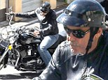 Easy rider! George Clooney goes hell for leather as he rides chopper in Italy