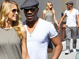 Holding hands: Eddie Murphy and girlfriend Paige Butcher locked fingers on Friday while walking in Beverly Hills