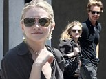 Putting a smile on her face! Ashley Olsen can't help but grin on shopping trip with a mystery man
