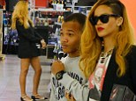 Rihanna enjoys a late night shopping trip with her brother Rajan after toxic Twitter exhange with Chris Brown