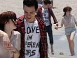 Carly Rae Jepsen cosies up to beau Matthew Koma as pair enjoy romantic beach stroll