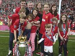 Delight: Sir Alex Ferguson celebrates with his grandchildren and the Premier League Trophy
