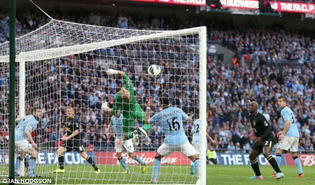 Over: Ben Watson's late winner consigned City to a disappointing season under the Italian