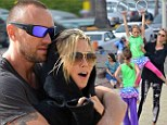 Big day out: Heidi Klum goes from sports field to beach side with daughter Leni and boyfriend Martin Kristen