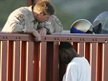 Savior: Kevin Berthia, right, was perched on the iconic bridge ready to take a fatal leap on March 11, 2005, when California Highway Patrol officer Kevin Briggs, left, talked him off the ledge and back to safety