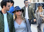 Just the two of us! Jennifer Aniston and Justin Theroux hold hands as they squeeze in romantic time for shopping and dinner