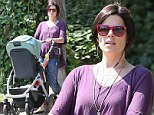 Neve Campbell celebrates her first Mother's Day weekend as she steps out for a stroll with nine-month-old son Caspian
