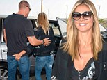Getting cheeky: Heidi Klum grabbed her boyfriend Martin Kirstin's behind as he picked her up from LAX airport on Saturday