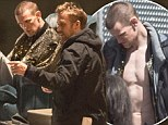 Better get those muscles pumping! Matt Smith tries to match up to Ryan Gosling as he joins him on set...and works out sporting new shaved head look