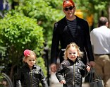 Doting dad: Matthew Broderick took daughters Tabitha and Marion home from school in New York on Monday