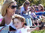 Denise Richards treats Charlie Sheen and Brooke Mueller's twins to a family day out... while their mother remains in rehab