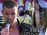 Pumping iron! Matt Smith tries to match up to muscular director Ryan Gosling as he joins him on set...and works out sporting new shaved head look