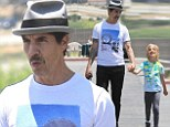 Doting dad: Anthony Kiedis took his smiling son to the Malibu Farmers Market in Malibu, California on Sunday