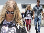 Sexy church pants! Pregnant Fergie headed to a Sunday service with husband Josh Duhamel in skin tight leather trousers
