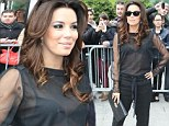 Daring to bare: Eva Longoria flashed her bra in a sheer blouse in Paris on Monday