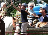 Time to saddle up! Neil Patrick Harris and David Burtka cheer from the sidelines as their twins ride ponies at a Farmer's Market