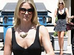 Beverly Hills babe: Ali Larter flaunts her toned pins in flirty skater's skirt while shopping for luxury goods