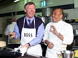 Boss in the kitchen: Sir Alex Ferguson, pictured with Chef Ken Hom, says he enjoys cooking Chinese food